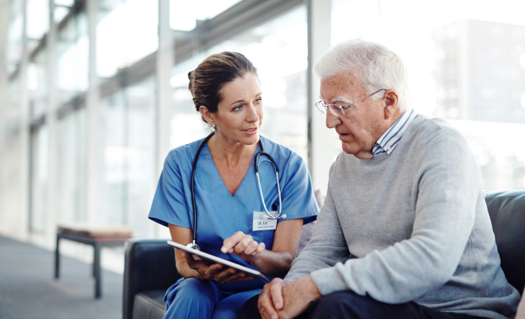 A female nurse explaining something to her patient