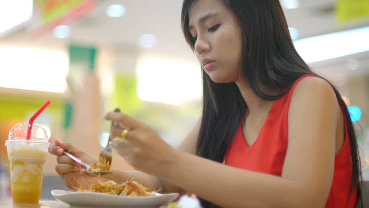 A lady eating food