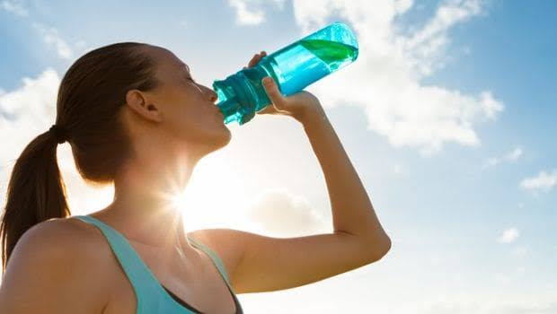 A sports girl drinking electrolytes drink