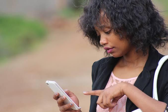 A lady checking her period with mobile app