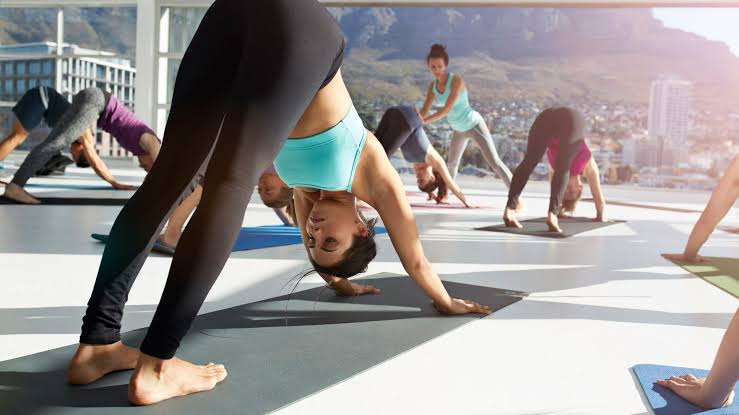 People performing physical active yoga