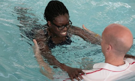 A lady swimming with her friend