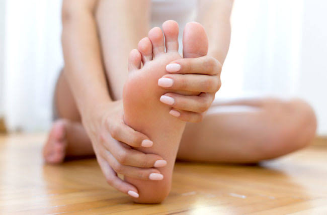 Plantar fasciitis is a common cause of pain under the heel.