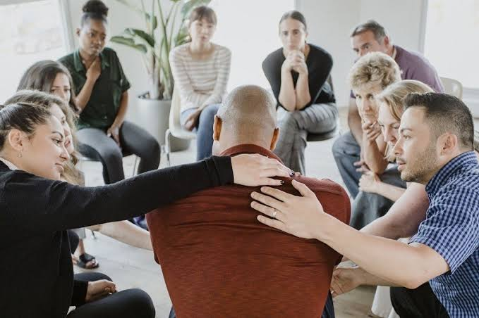 Attending group therapy may help a person to build healthier relationships with others.