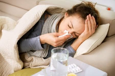 A lady suffering from flu