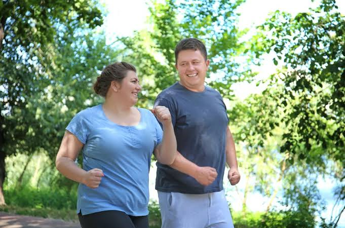 Fat couples running