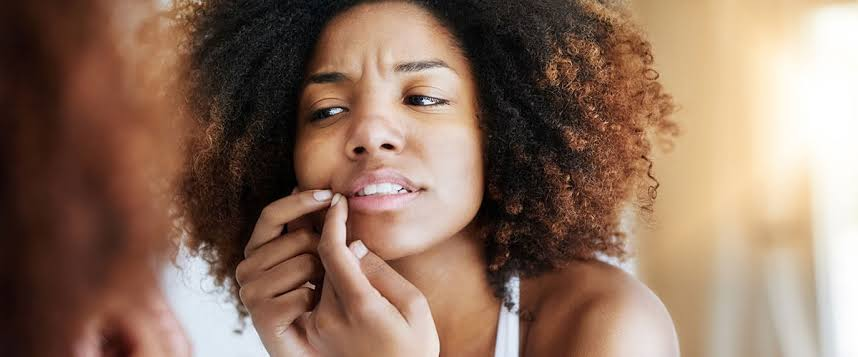 A ladY Squeezing a pimple