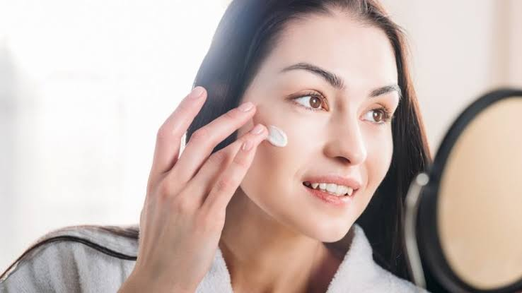 A lady using face cream