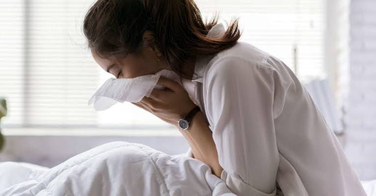 A lady having cough or common cold