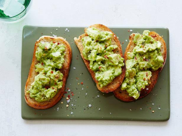 Avocado on toast is a healthy snack for Mediterranean diet followers.