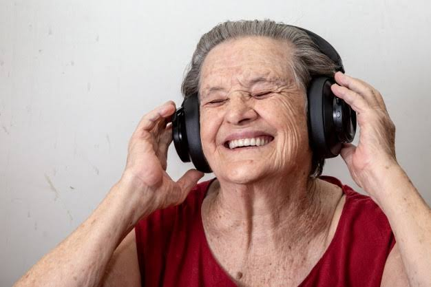 Old woman dancing to music
